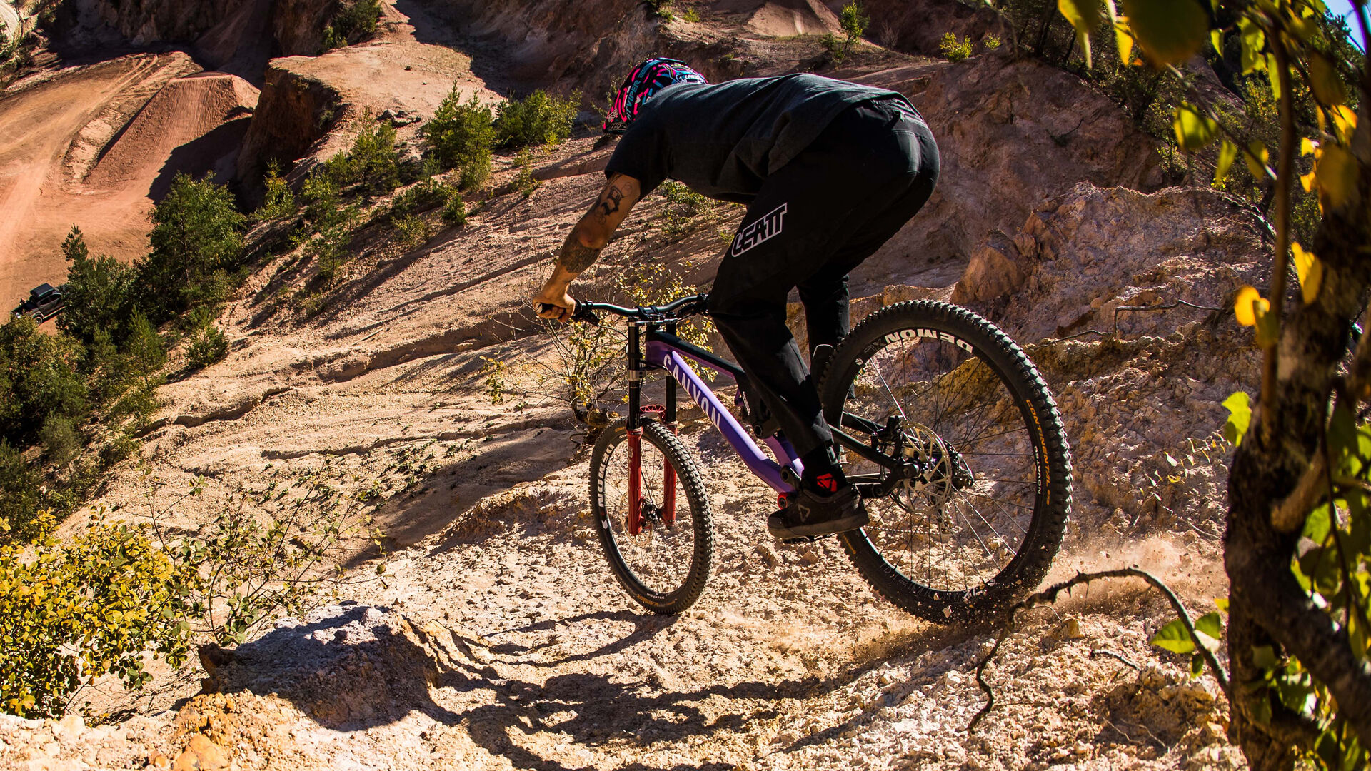 man riding with a canyon sender downhill bike